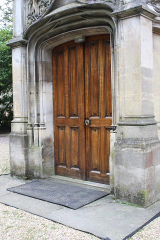 Oak linenfold door to the Crypt.