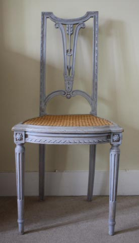 One of a pair of mid 20th century Louis XVI style chairs.