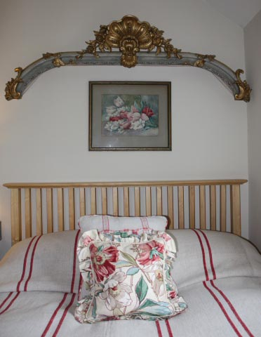 Late 19th century parcel gilt cantonniere shown placed above a bed.